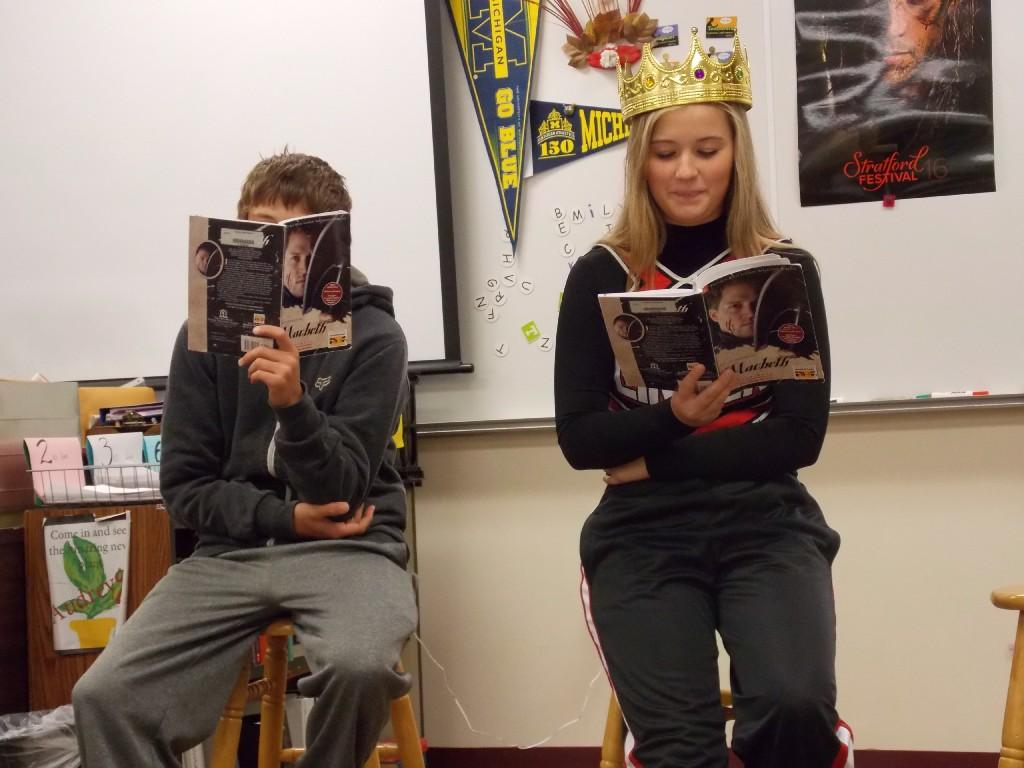 Two students reading Macbeth