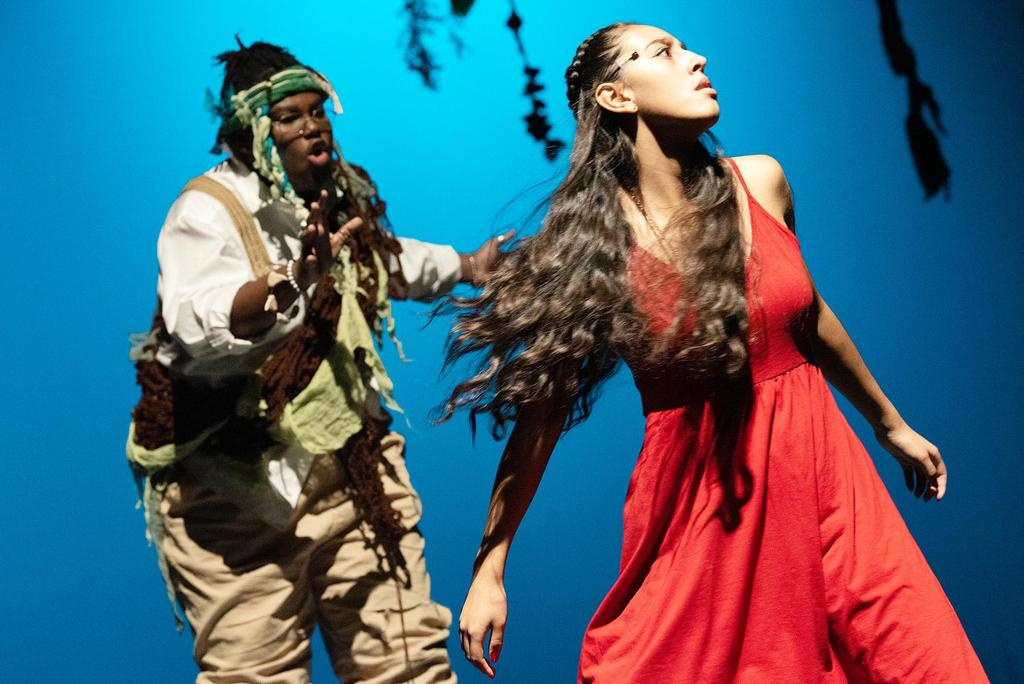 Darren Pierre, who plays Agwe, God of Water, reaches out to Jhalyshka Feliciano, who plays Ti Moune and whose head is tilted to the sky while leaning backwards