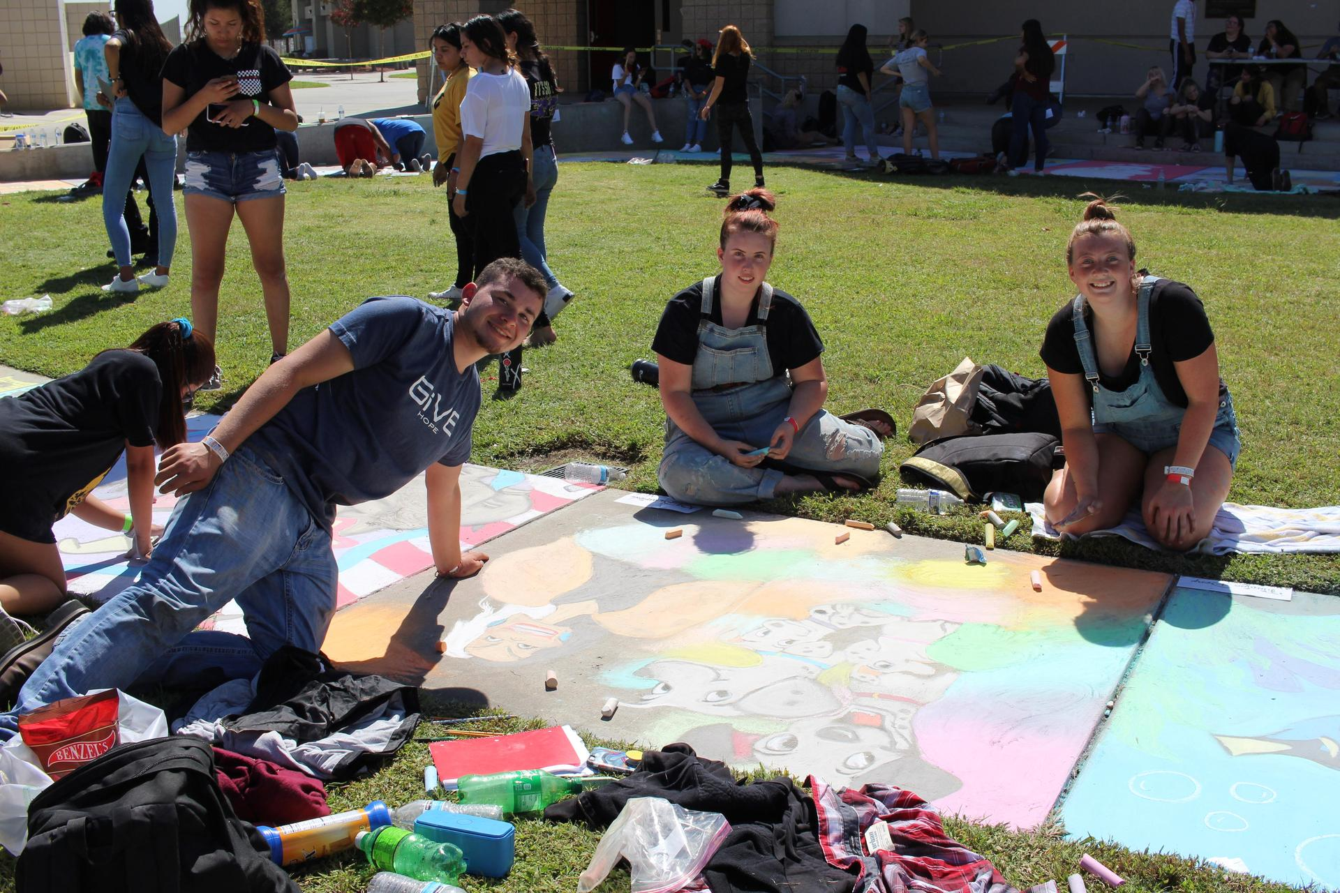 Students at sidewalk chalk