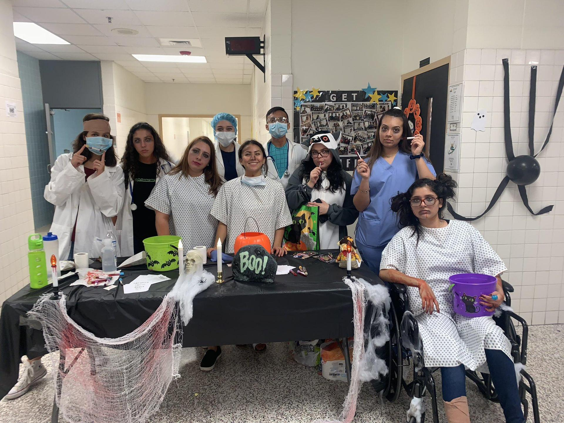 students in medical attire posing for a picture