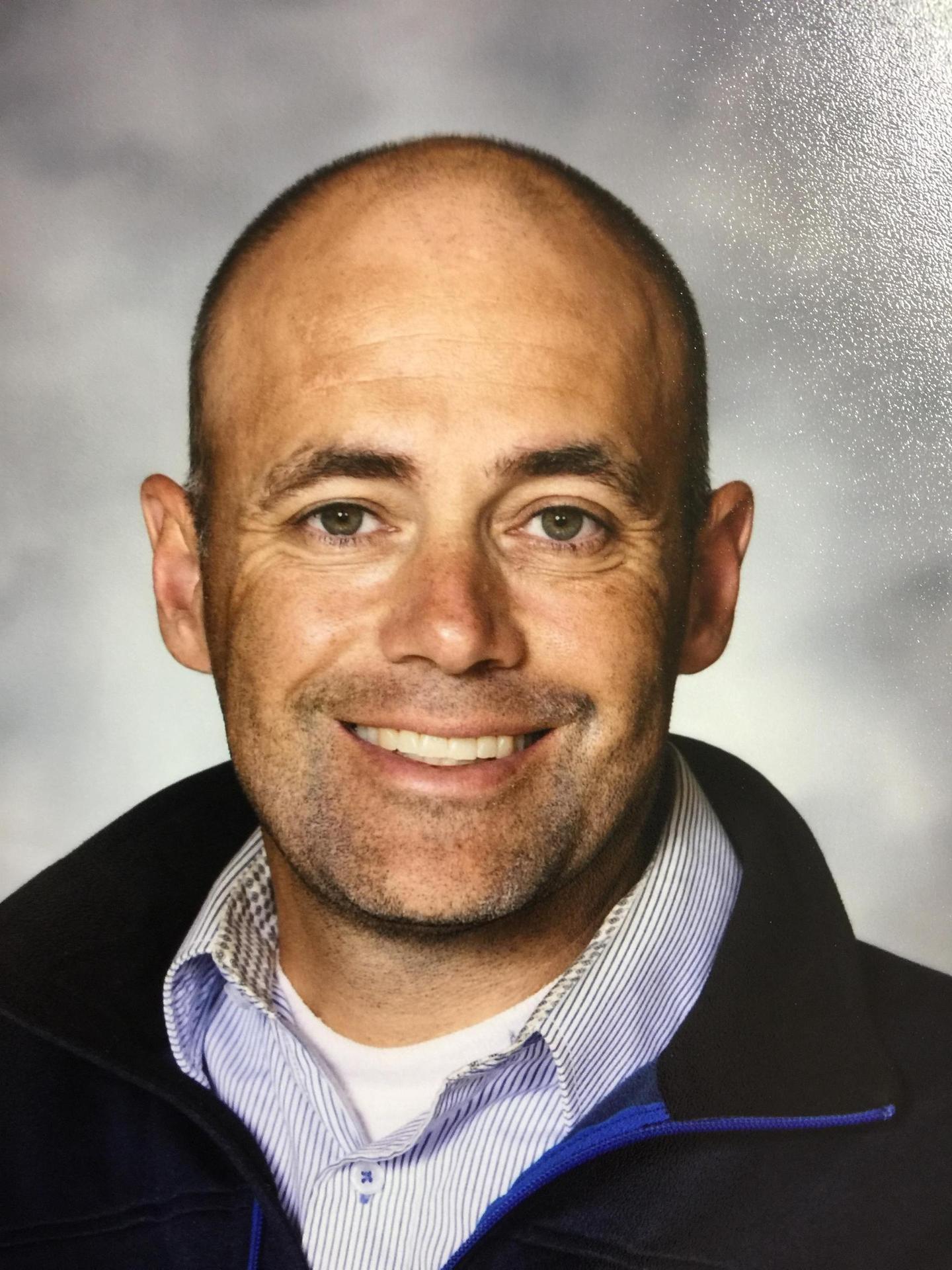 Head Coach James Weckesser