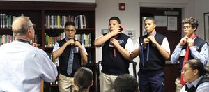CWSP Program Coordinator Paul Tanklefsky Teaches Incoming Freshmen Boys How to Tie a Tie.JPG