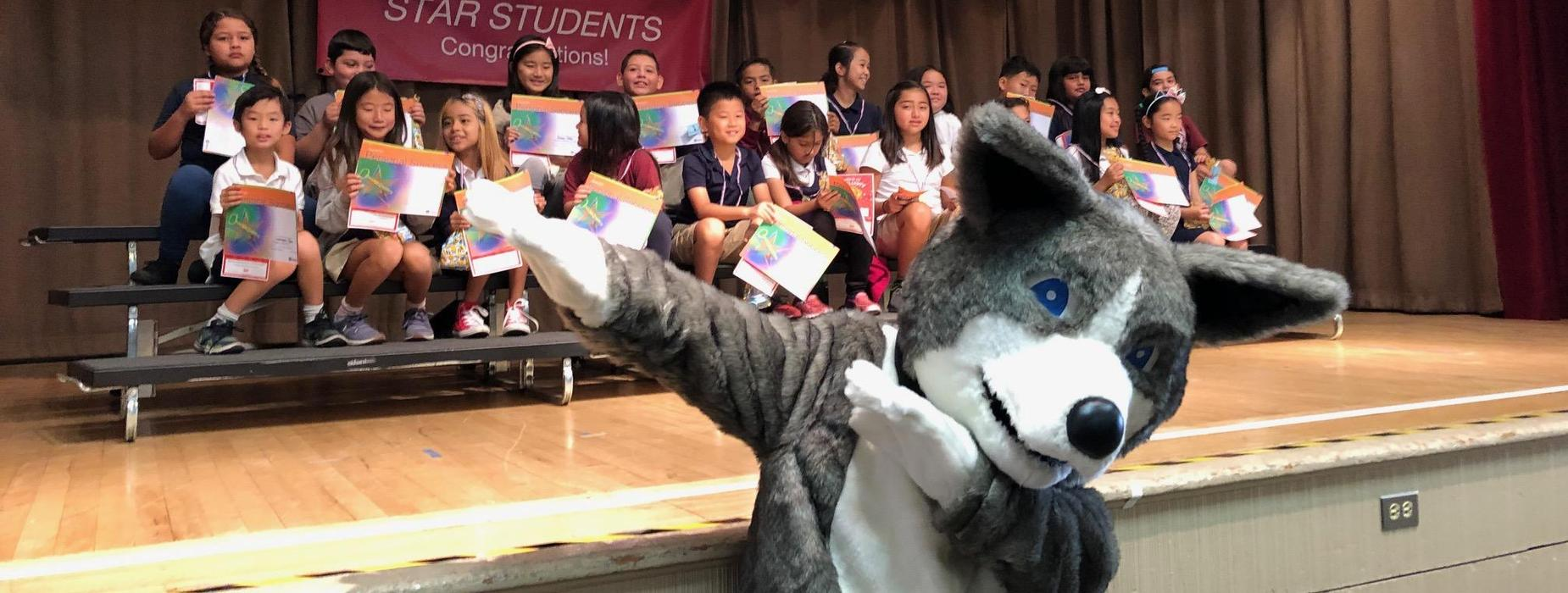 Marguerita Husky and students at assembly