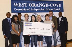Education Foundation members present $10,000 check to Elementary