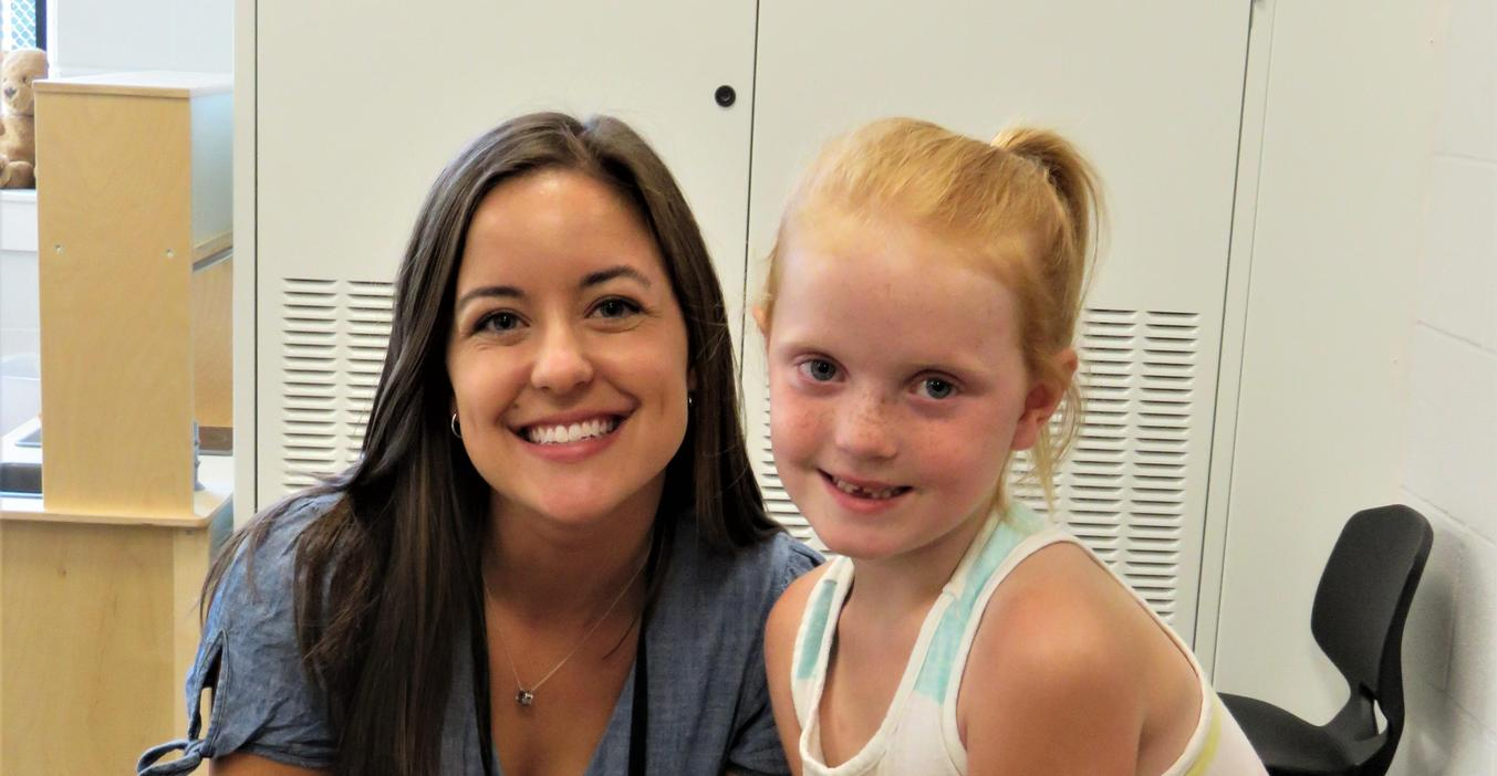 A McFall teacher greets new students to her classroom.