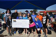 Brewer Middle School took home a $500 check for second highest fundraiser for the BRRRewer Bear Plunge on Jan. 26.