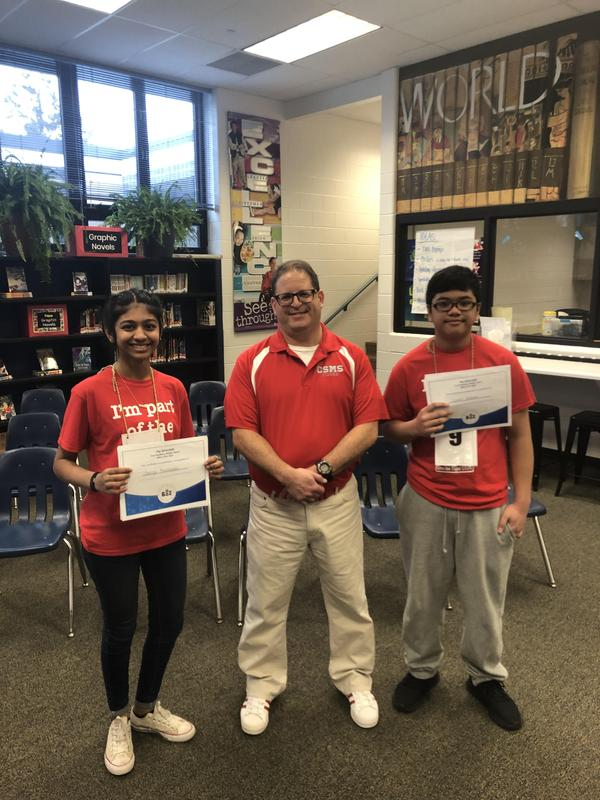 Spelling bee winner and runner up with Jeff Gange, organizer of the bee.