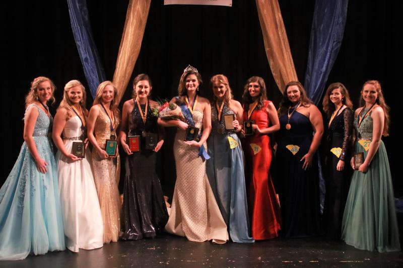 Pictured from left to right are the Top 10 contestants in the Miss FFA 2019 Pageant that was held at the Lexington Three Fine Arts Center on March 15th:  Hannah Hancock (Woodmont FFA); Annabelle Summers (Batesburg-Leesville FFA); Madison Towe (Seneca FFA); Kylie Cathcart (Lexington-Richland 5 FFA); Miss FFA 2019 Sydney Gambrell (Pendleton FFA); Hadley Smith (Pendleton FFA); Abigail Krasslet (Swansea FFA); Blakeley Elliott (Carvers Bay FFA); Grace Powell (Seneca FFA); Ivy Bryan (Pickens County Career and Technology Center FFA). Photo is courtesy of Shanez Padgett.