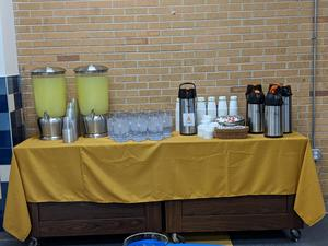 Beverage table with lemonade and coffee and water