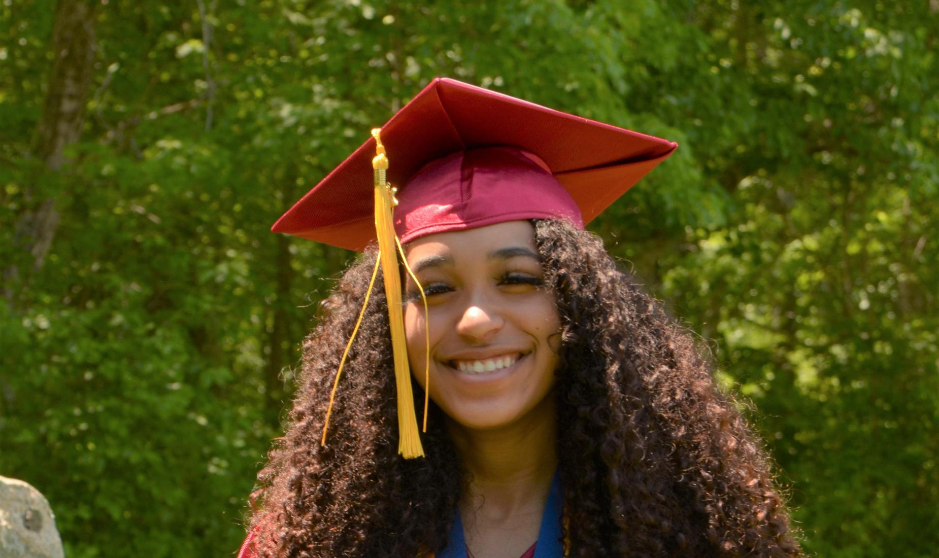 GLCPS graduate in cap and gown