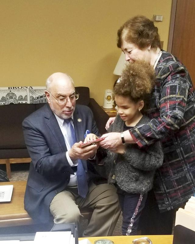 NYS Assembly Member Michael Benedetto look at Milagros artwork with Dr. Kappen