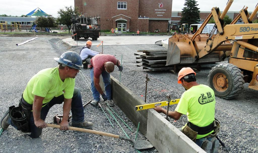 This picture shows four of the six-member concrete construction crew busy working August 22, 2018.