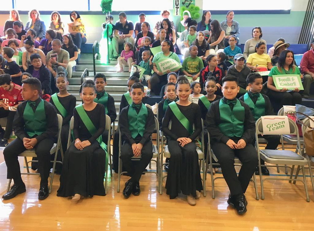 Edison Dance Team dressed in black with green pinnings