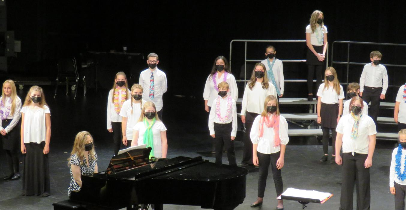 Students perform a choir concert.