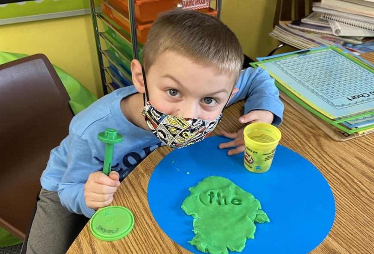 student with play dough