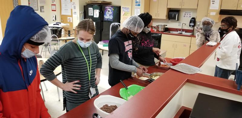 students preparing meals