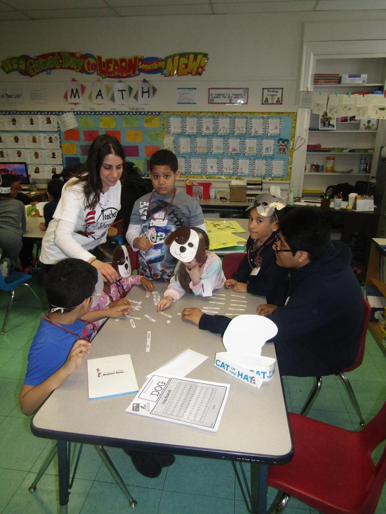 older kids working with younger kids on a dr. seuss activity