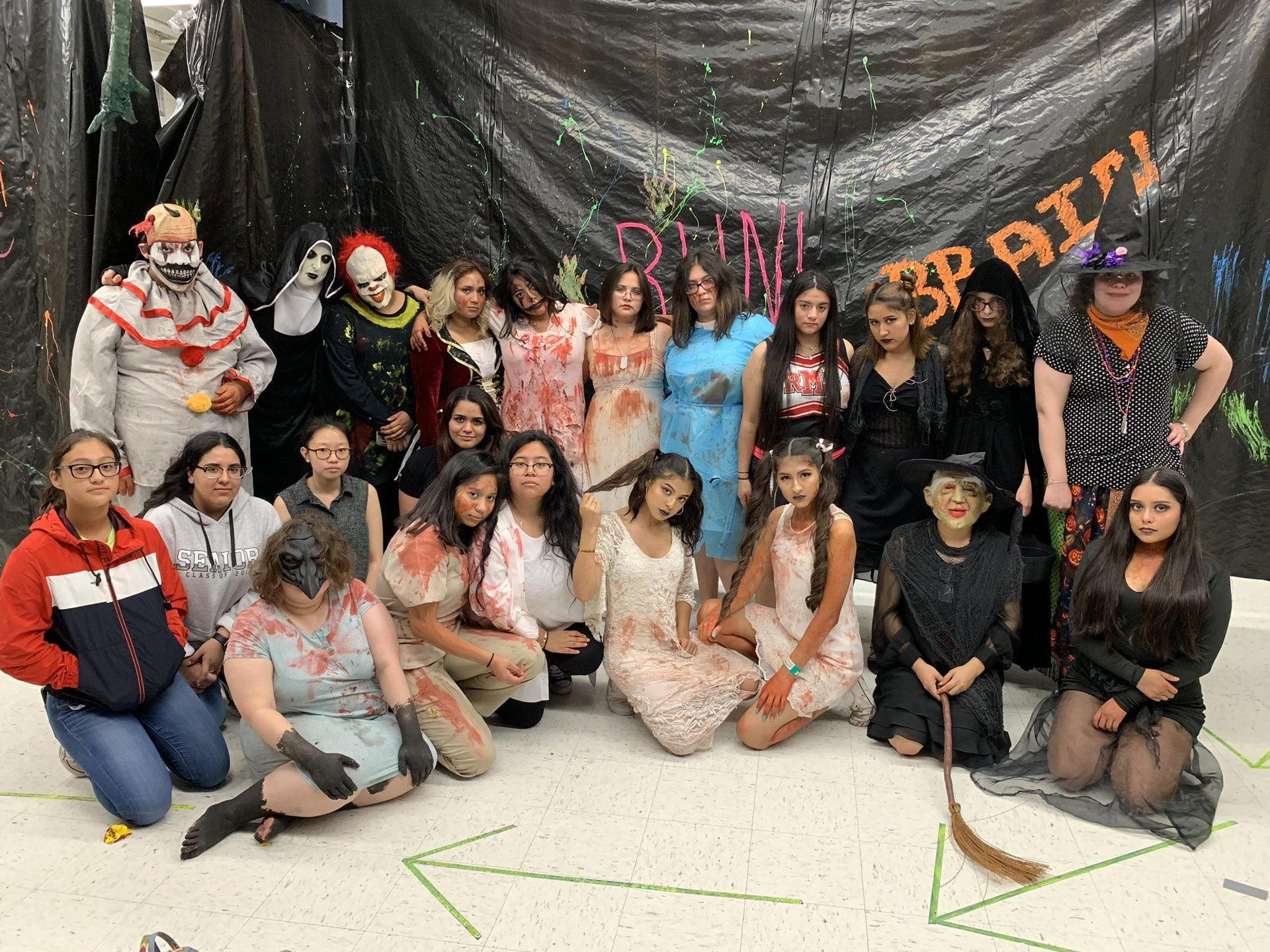 students in various costumes posing