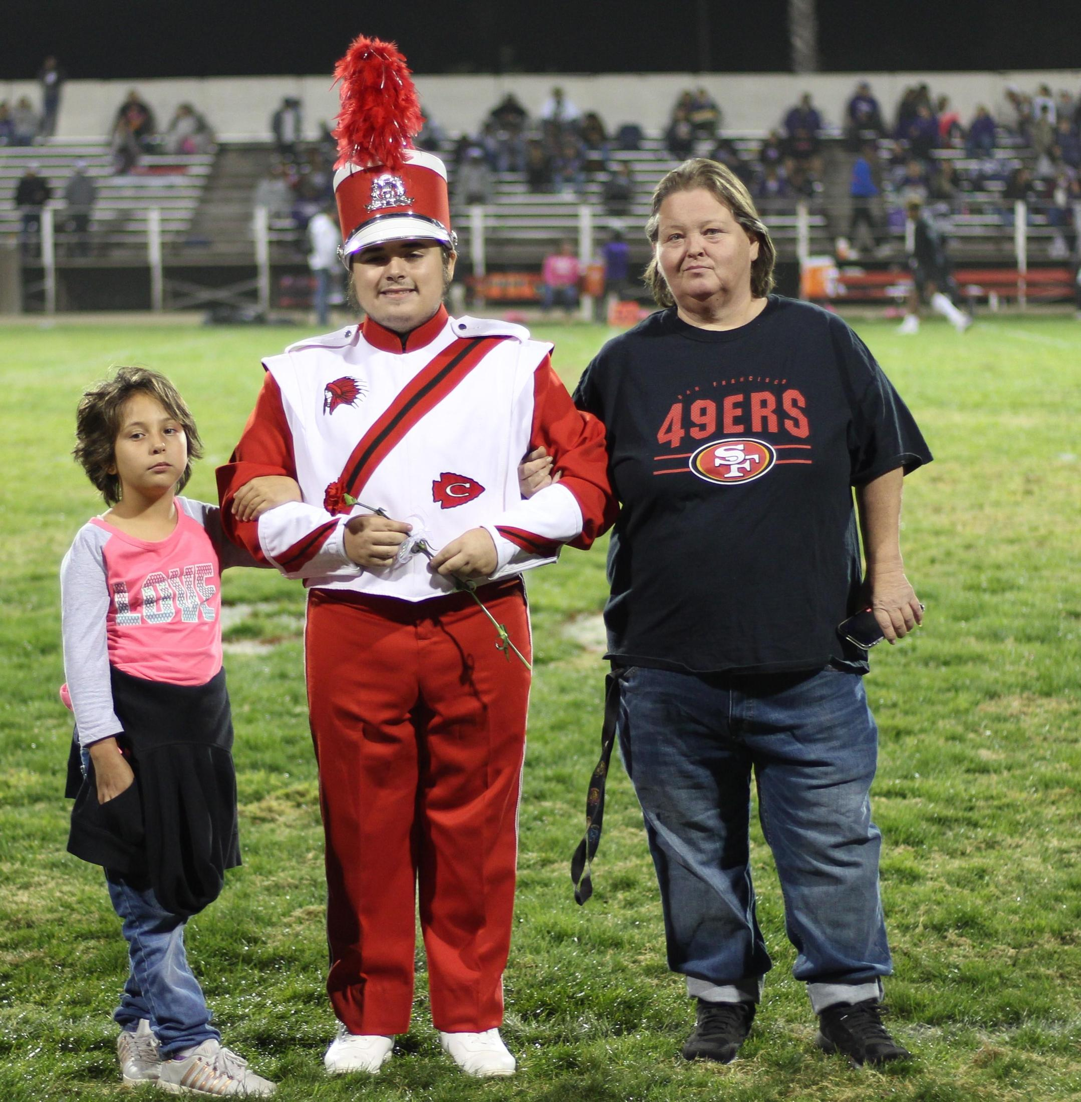 Senior band member Isaiah Bishop and his escorts.