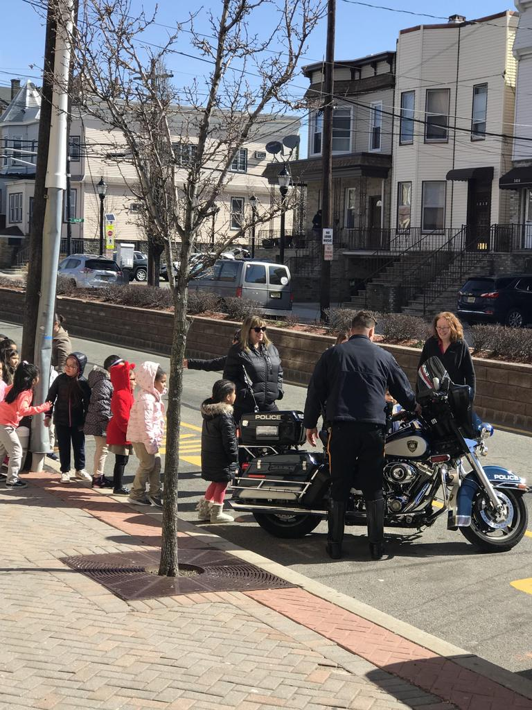 class of children learning about the pd motorcycle