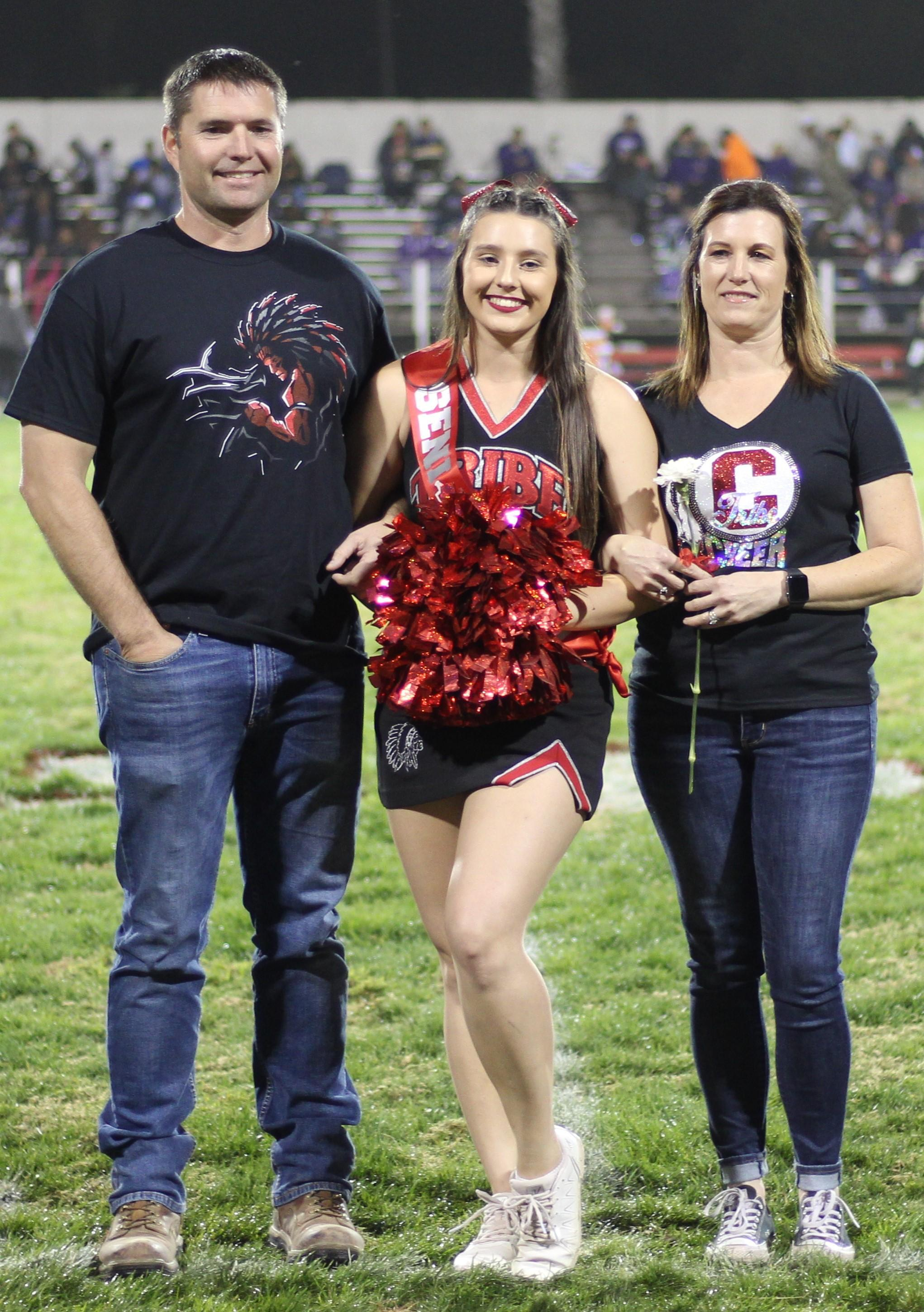 Senior cheerleader Grace Sheppard and her escorts.