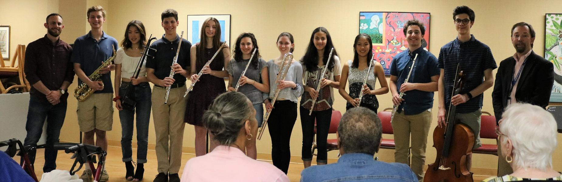 Photo of members of WHS Band posing for a picture after a volunteer concert for senior citizens.