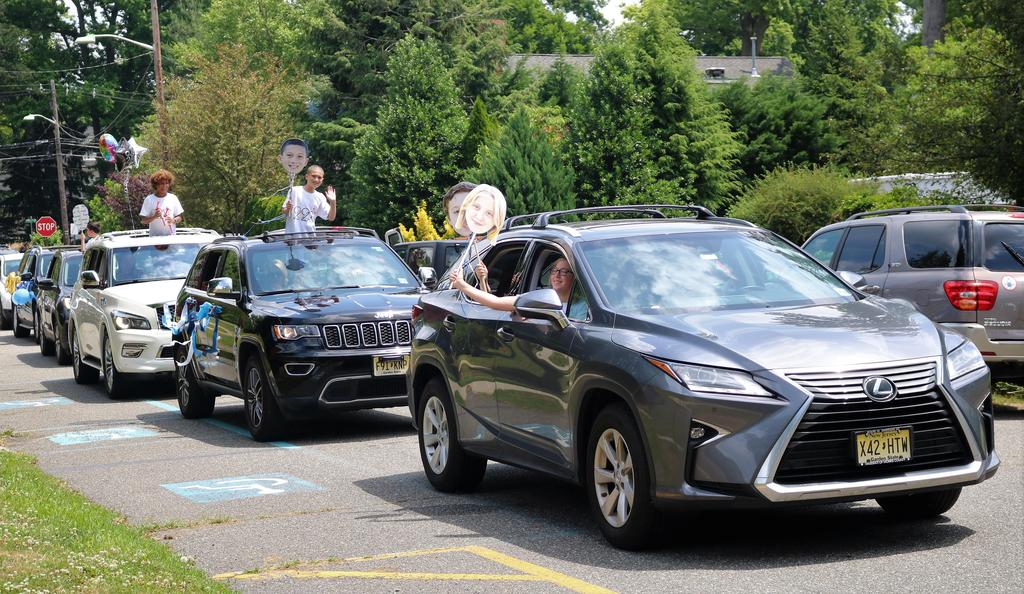 Photo of cars lined up for Wilson Grade 5 Clap Out Car Parade.