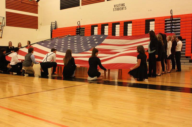 Students holding the American Flag