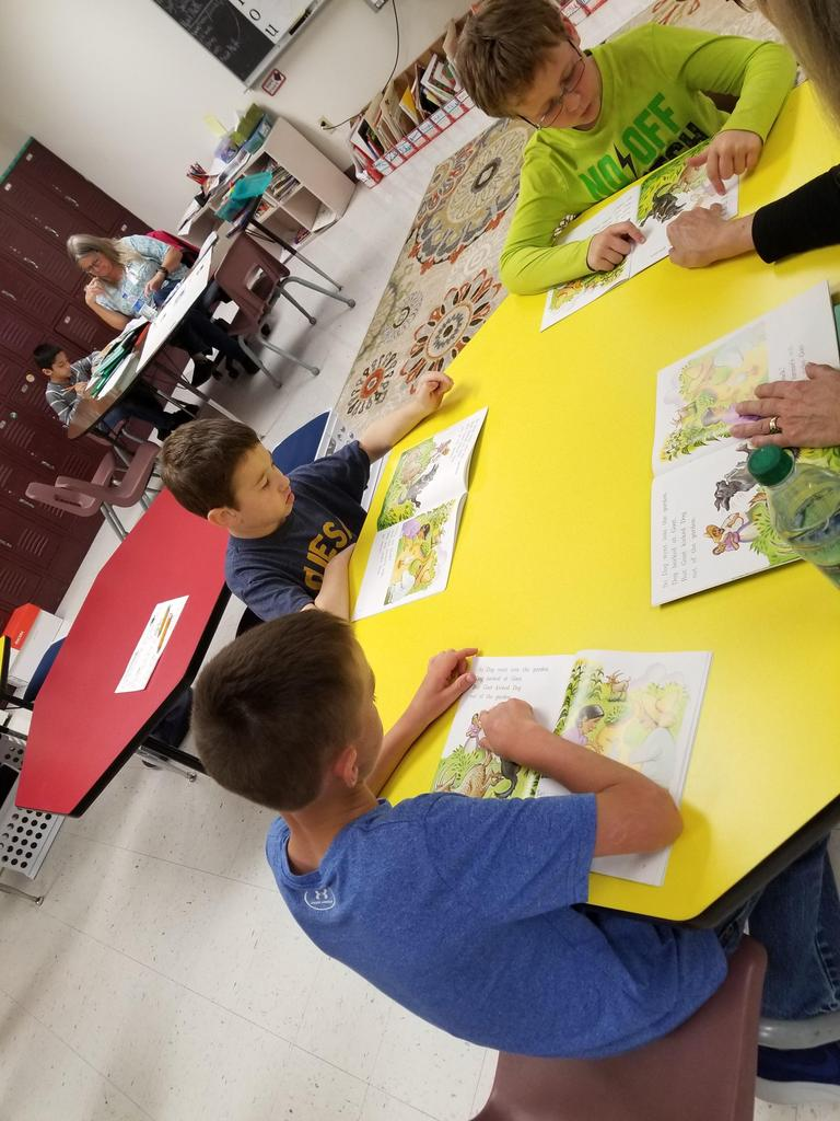 working on their reading with Leveled Literacy Intervention Books