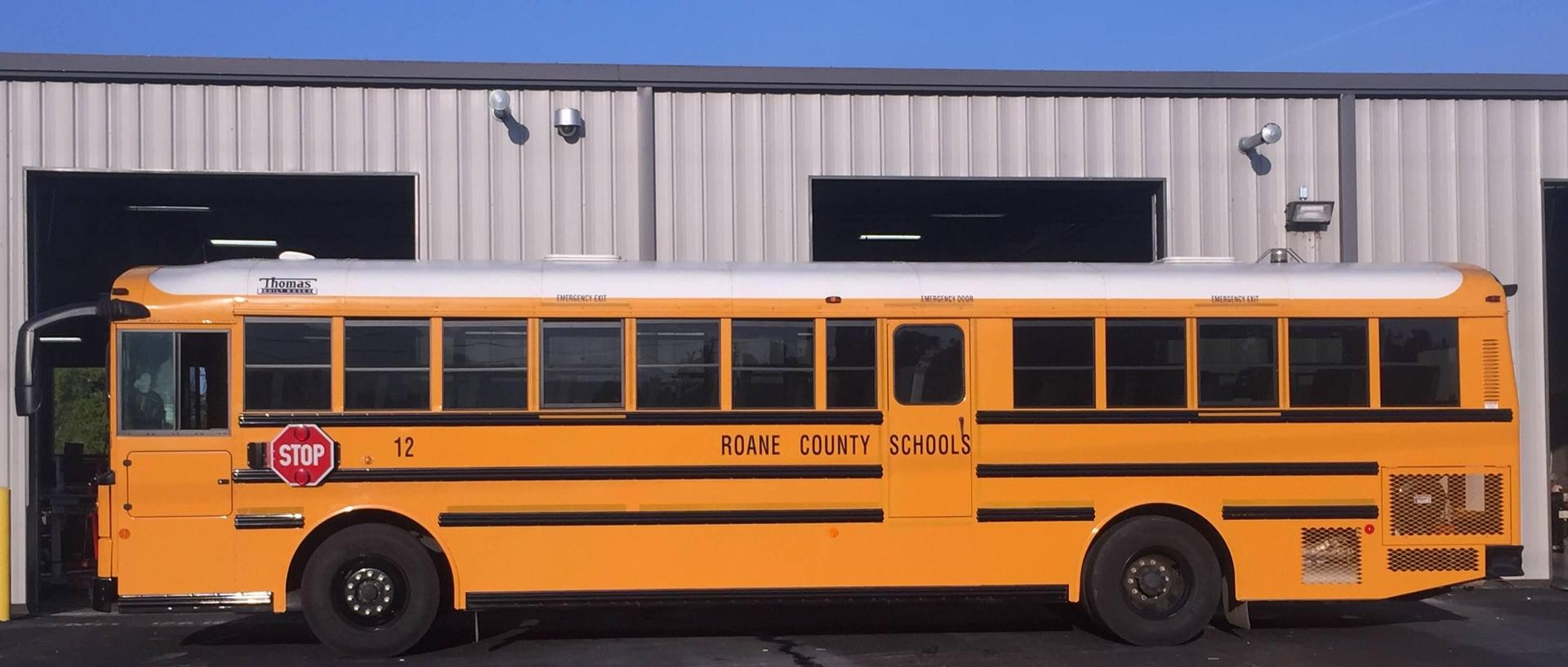 Roane County School bus in front of bus garage