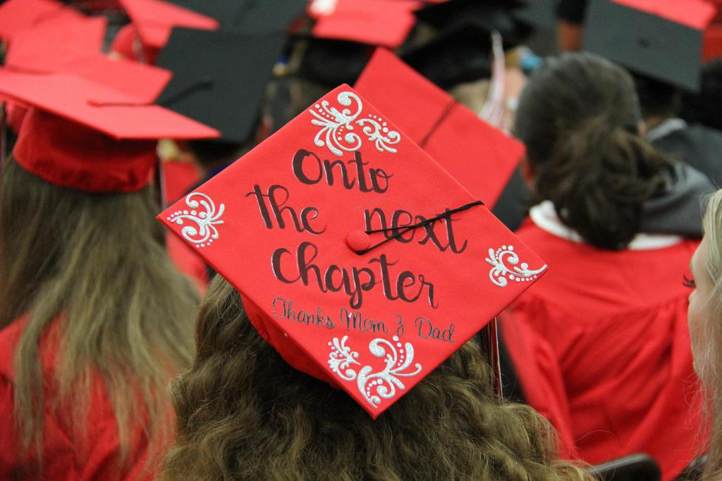 """Graduation cap that says, """"Onto the next chapter, thanks Mom and Dad""""."""