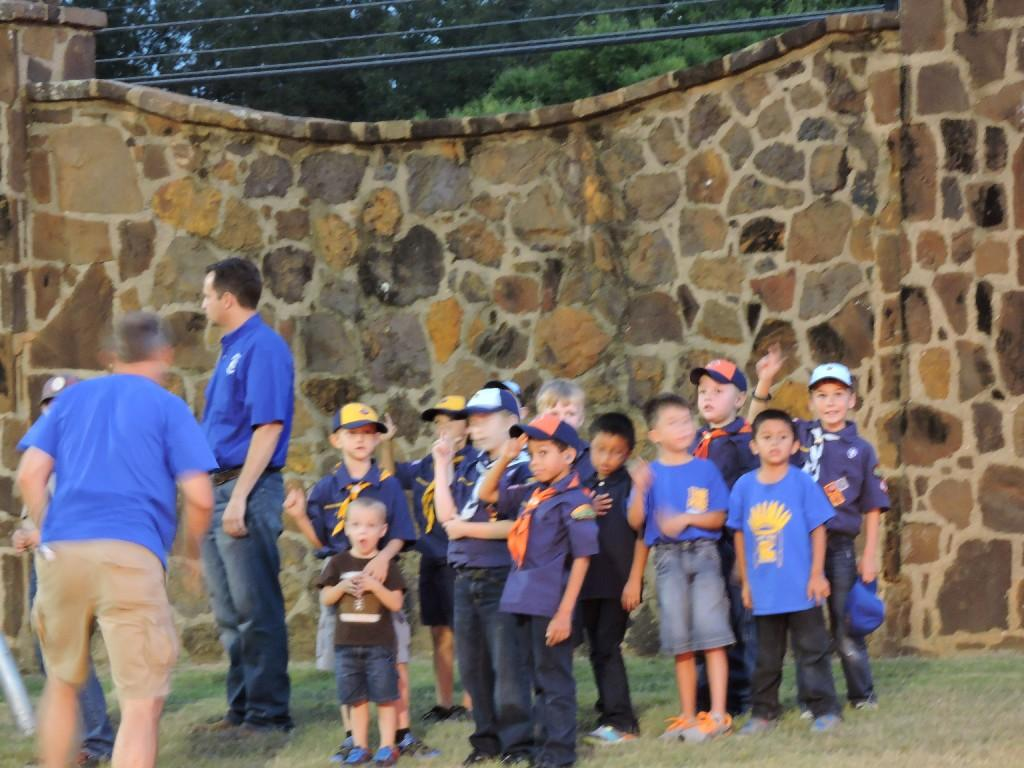 scouts raising the flag at tomato bowl