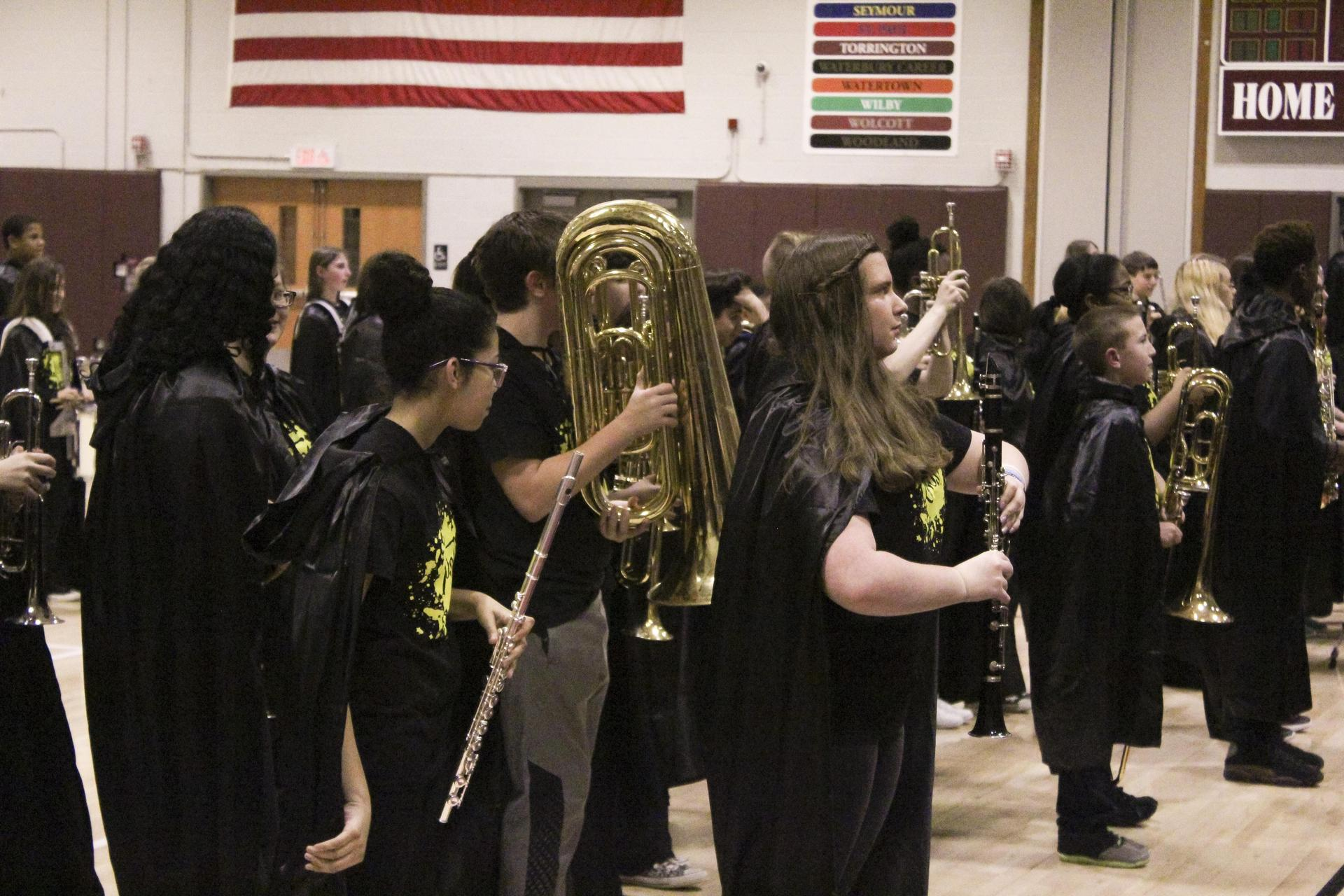 SoundSport musicians playing concert in high school gym