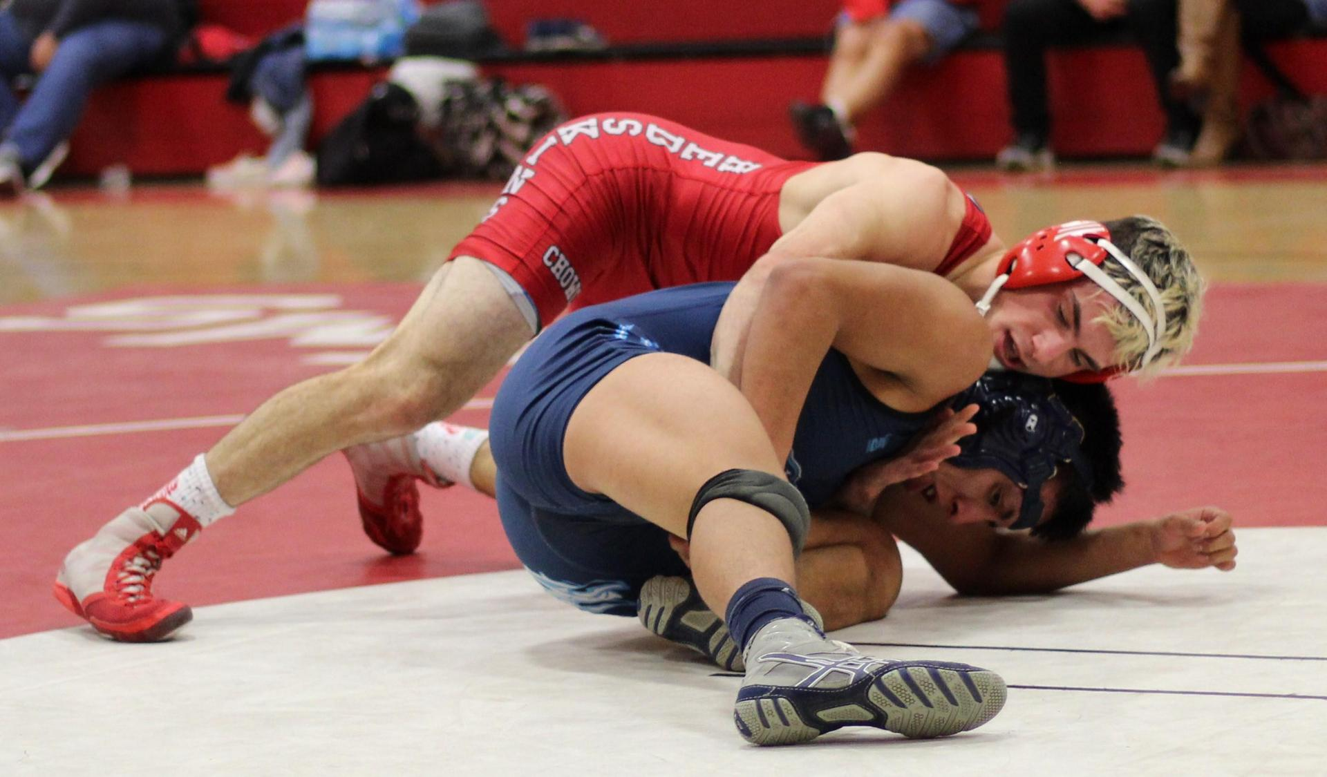 Chowchilla high wrestlers in action at Kerman.