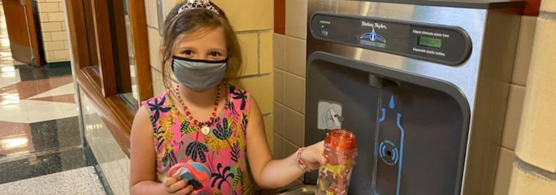 image of student filling water bottle at new water filling station