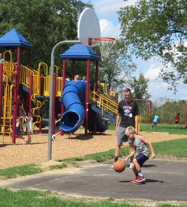 TKHS football players serve as mentors on the playground at Lee.