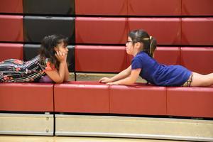 2 kindergarten girls bonding over small talk during free time.