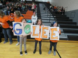 Lee students made signs to cheer on their school team last year.