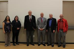 Staff pictured with local legislature