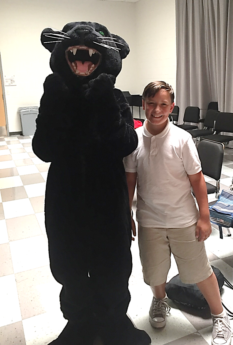 Male student posing with panther mascot