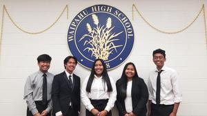 Five students from Waipahu High School selected as Presidential Scholars candidates pose in front of WHS seal