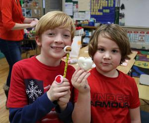 Photo of two students at McKinley School enjoying Valentine's Day activities.