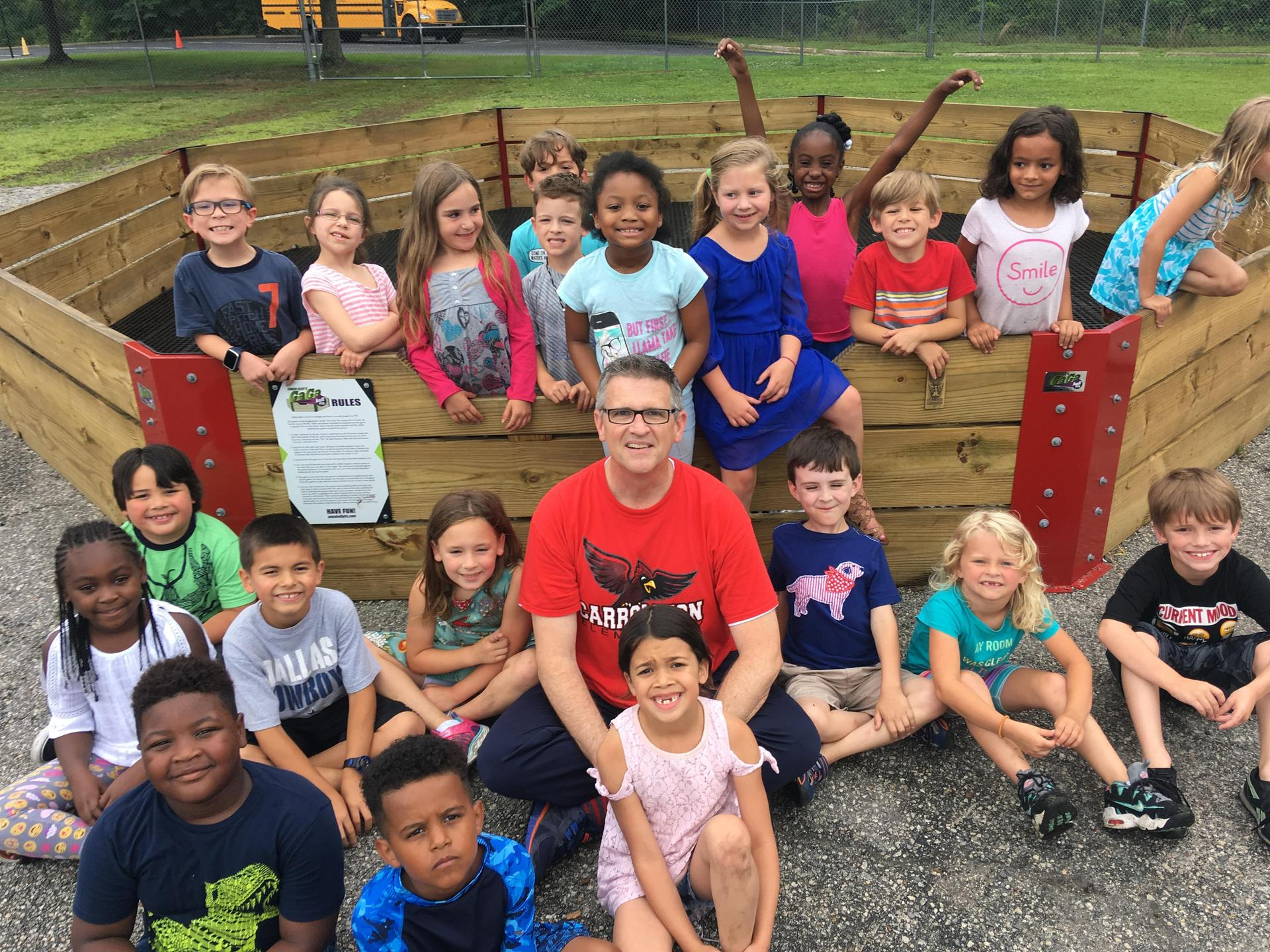 mr. brennan with students in front of gaga pit