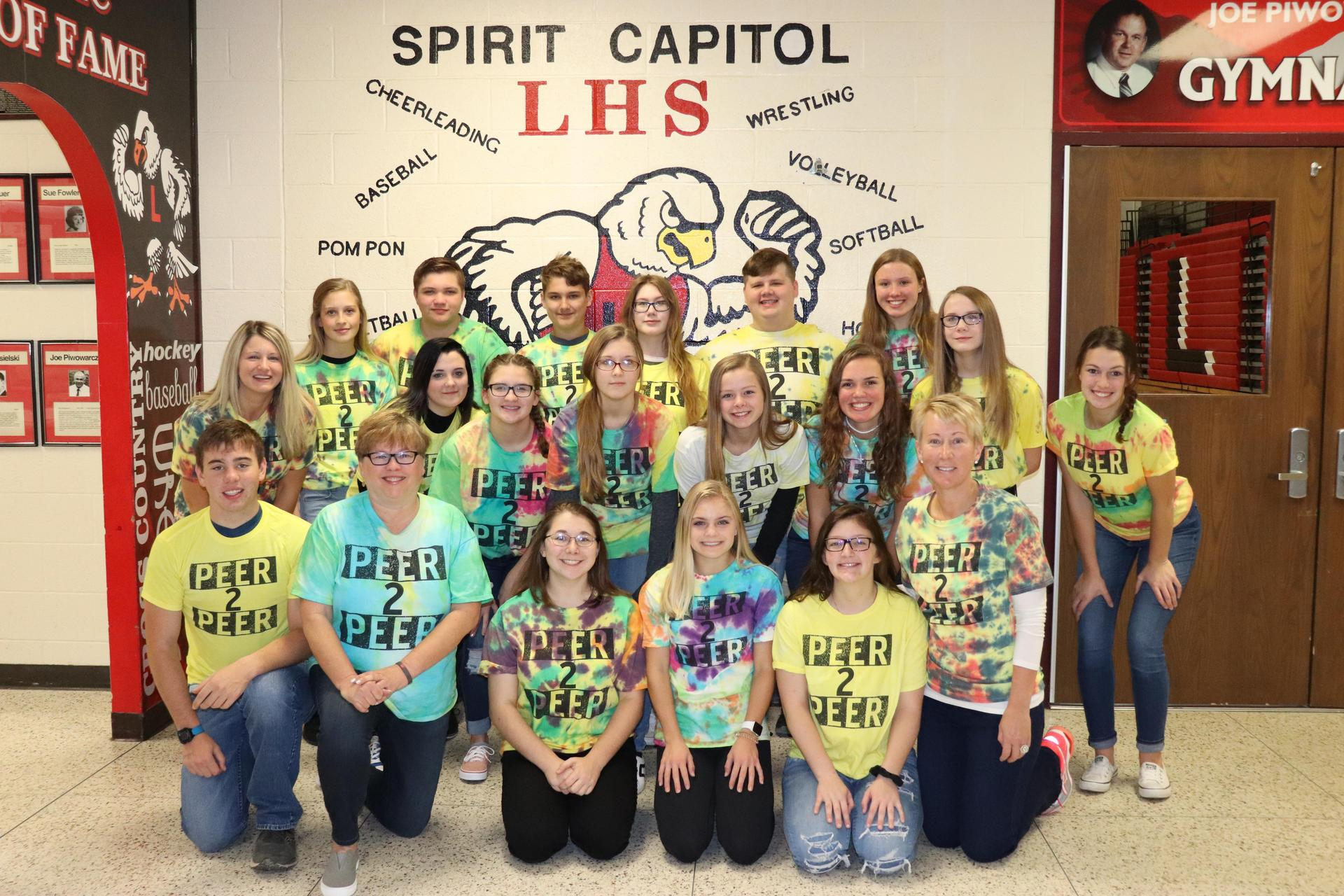 Group of students and teachers wearing tie-dyed t-shirts
