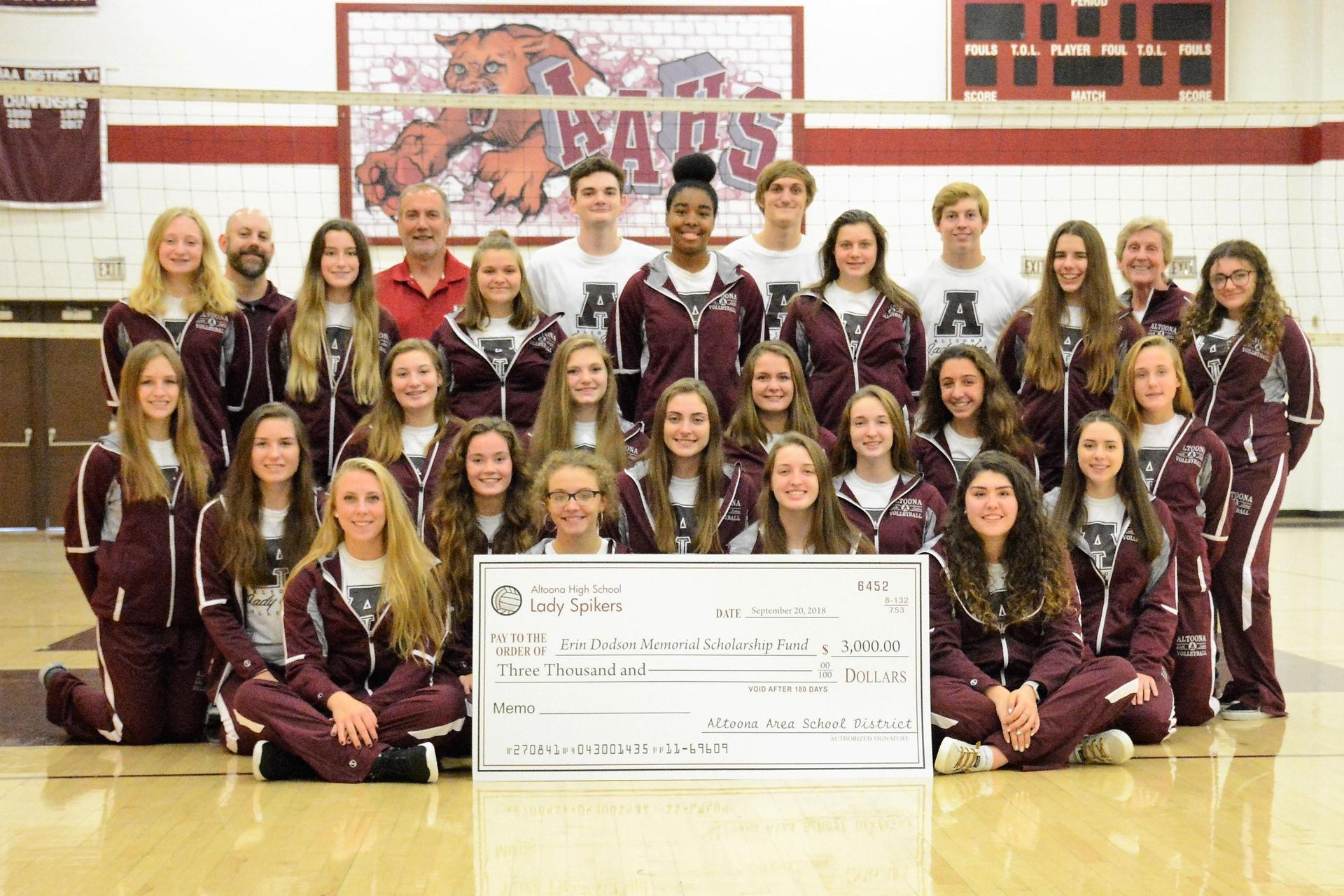 Volleyball team with Scholarship Check