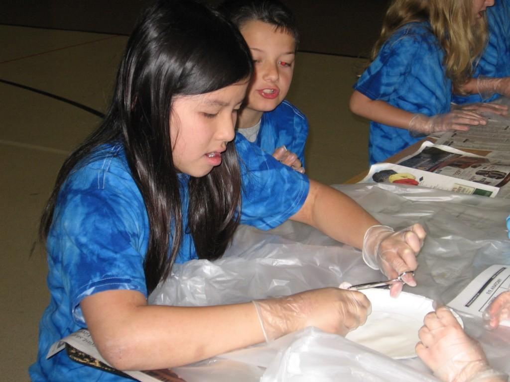 students in tie dye shirts prepare for dissection