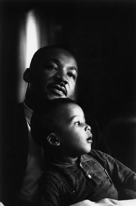 MLK with Child- Copyright Flip Schulke