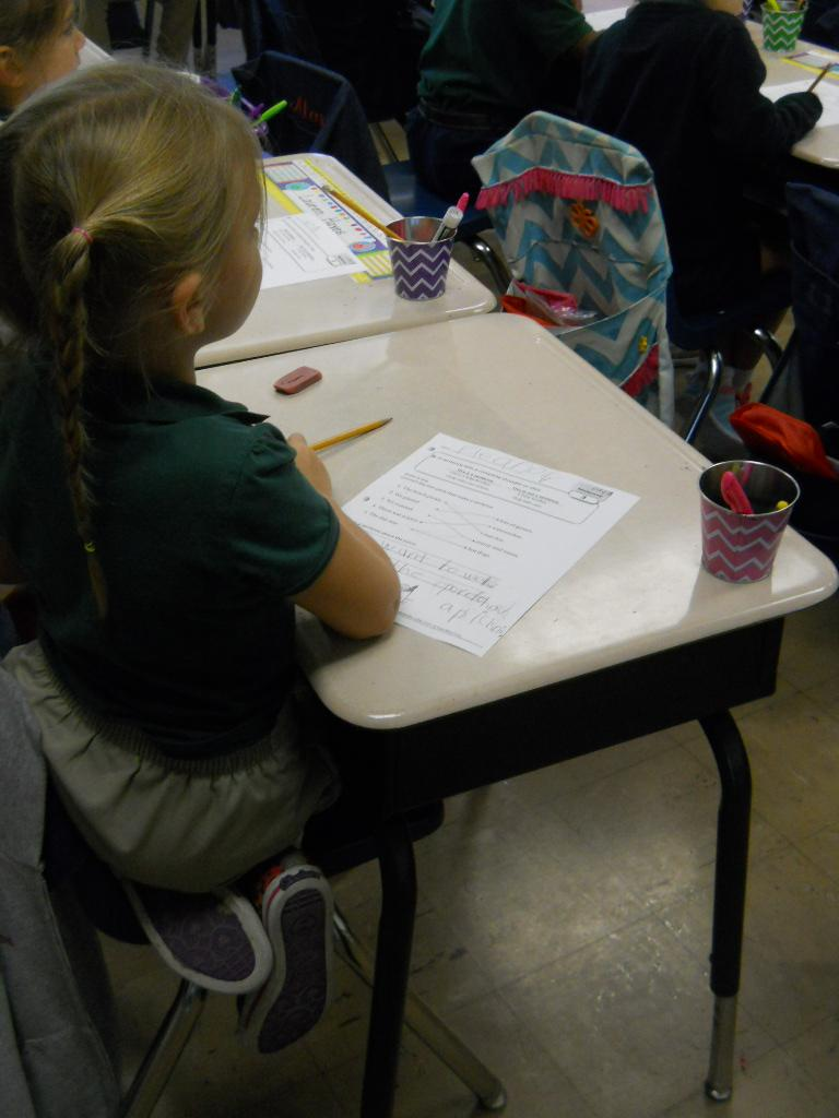 WES student paying close attention to her teacher.