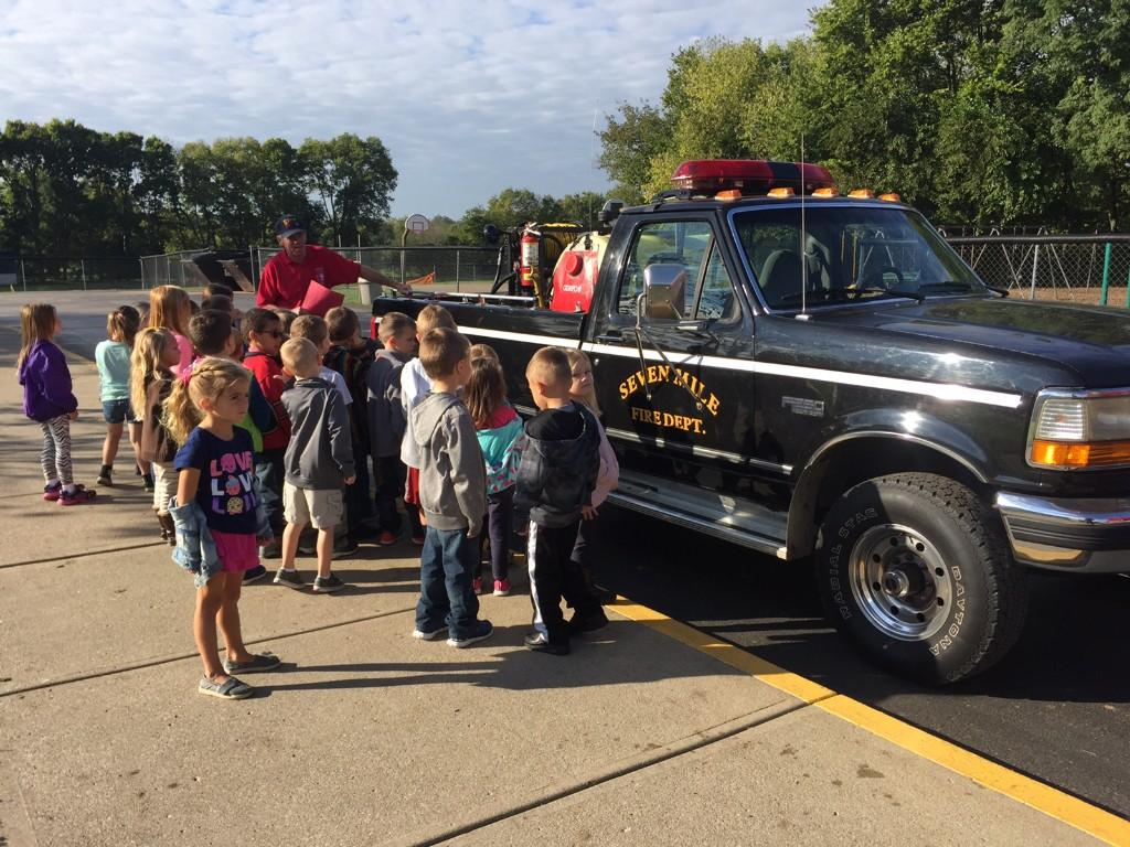 Kindergarteners learning about fire safety.