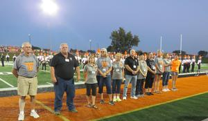 Officers and trustees of the TK Alumni Association are honored at the Homecoming football game and served as grand marshals in the parade.